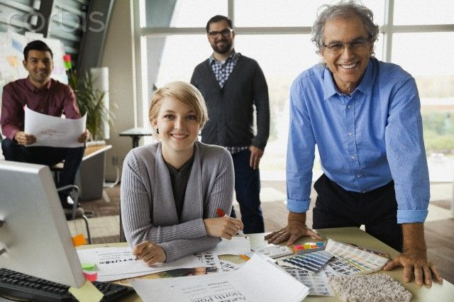Portrait of confident business team smiling in office