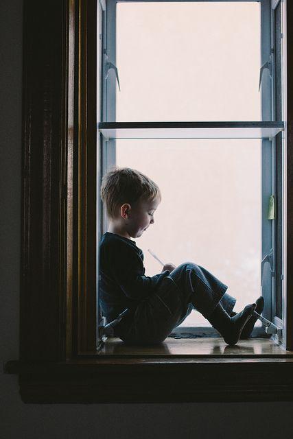 Little boy enjoying a window seat