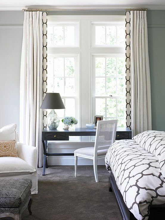 Gorgeous white drapes with patterned black trim on leading