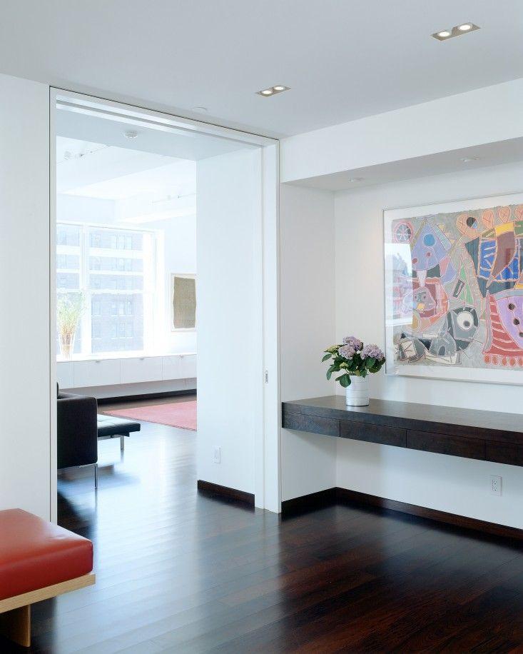 NY loft by Delson Sherman, full height sliding pocket doors, Brazilian walnut floor | Remodelista