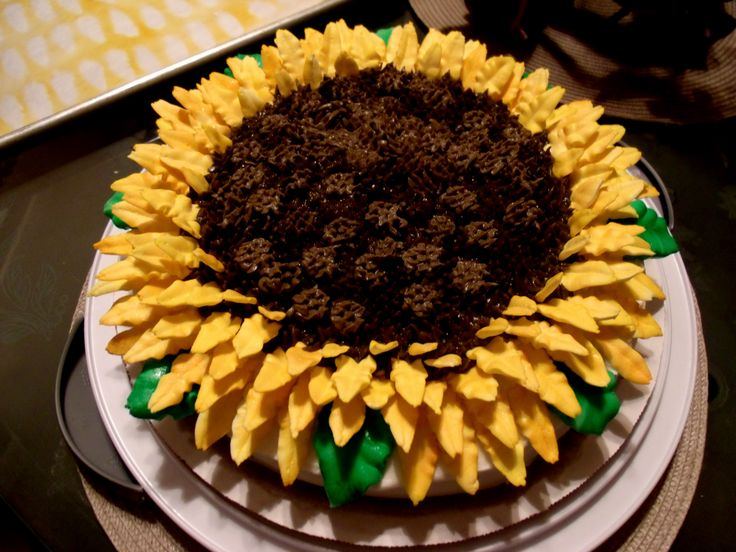 Sunflower birthday cake.  Royal icing petals & leaves.  Choc buttercream for center
