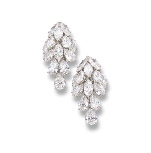 A PAIR OF DIAMOND EARRINGS, BY HARRY WINSTON Each designed as a cluster of pear…