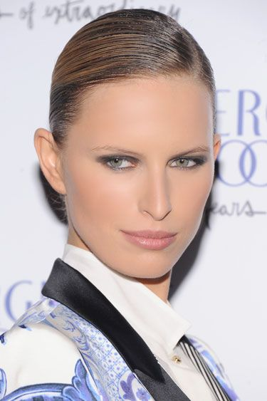 """Today's beauty secret: Smoky Lids - As seen on: Karolina Kurkova. How-to: """"A goofproof way to create a smoky eye is to use a gel or cream-based liner and shadow,"""" says beauty editor Jessica Prince. """"Rim your upper and lower lash lines with a black pencil and then blend a deep gray or black shadow with your finger from your lashes to your creases.""""    Editor's pick: Chanel Illusion D'Ombre Long Wear Luminous Eyeshadow in Mirifique."""