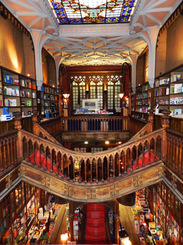 Portugal's Lello Bookstore, founded in 1906, is one of the most beautiful bookstores in the world. Designed and built by engineering professor Xavier Esteves, it is a stunning example of neo-gothic design and features stained glass, carved wood, and a spectacular art nouveau curved staircase. Pillars are decorated with bronze bas-reliefs of Portuguese literature figures.