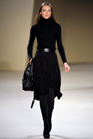 Black mock neck dress with knee high heel boots, black tote - Nice fall/winter wear (Akris FW 2012)