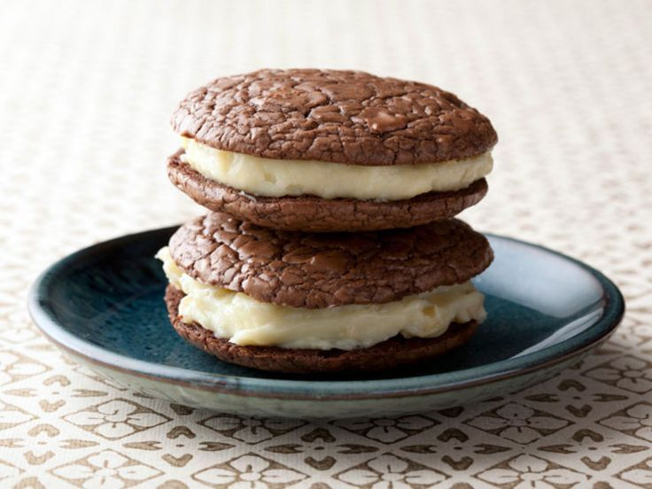 Dark Chocolate Whoopie Pies with Toasted Almond Cream recipe from Alex Guarnaschelli via Food Network