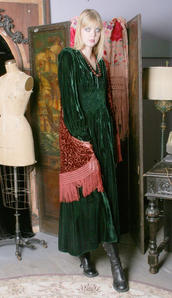 Beautiful gathered emerald green velvet dress.  I would like the outfit *and the room, please.
