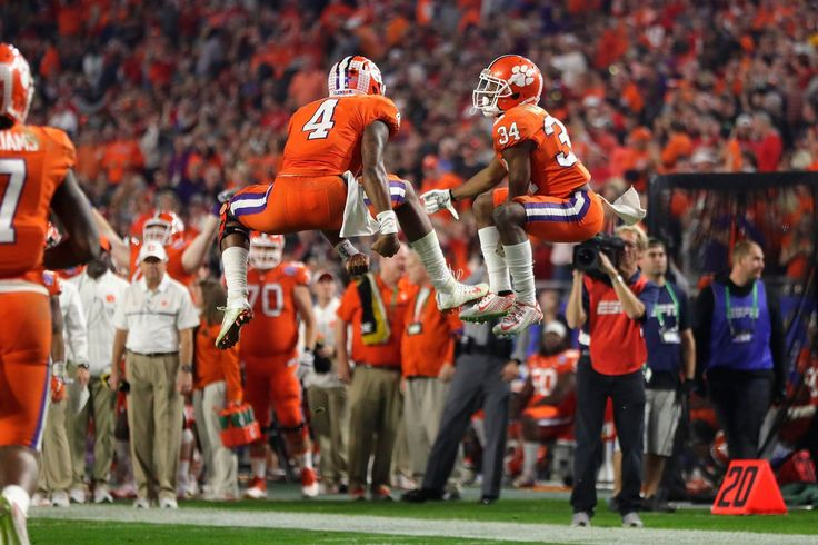 Clemson QB Deshaun Watson (4) and RB Ray-Ray McCloud celebrate a touchdown.  Clemson made no one doubt it deserved a second chance to beat Alabama for the national championship with a 31-0 drubbing of Ohio State in the Fiesta Bowl.  Hours after the Tide dominated Washington in the Peach Bowl, Clemson