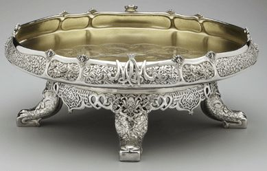 Silver Ice Cream Dish, c.1877- c.1878. Created by, Tiffany & Company, NYC. Embellished with floral ornamentation and resting on four feet, which are designed in the shape of elephant trunks. ~ {cwlyons} ~ (Image: antiquesandhearts)