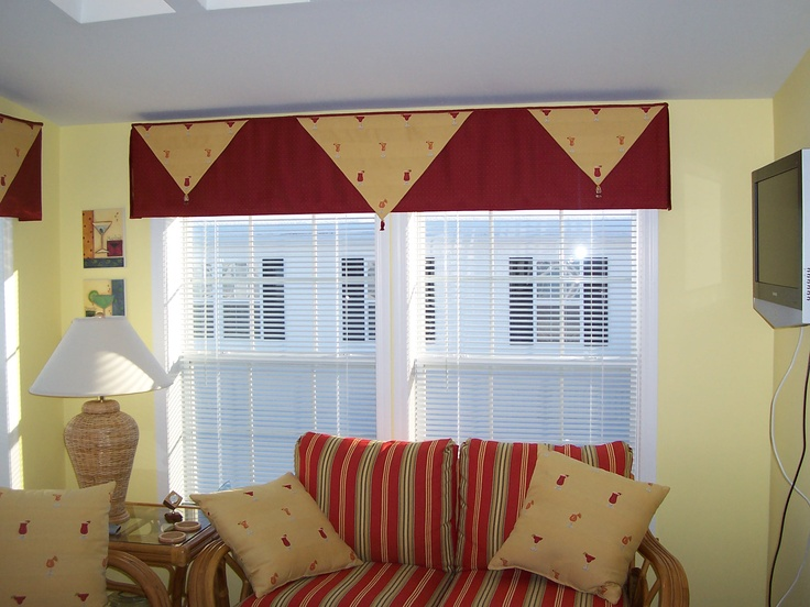 This sunroom valance was designed around the little bit of fabric that was leftover from the cushions and pillows.  We needed to create a treatment using the yellow print which was very small and stretch it out for 2 large windows and a sliding door.
