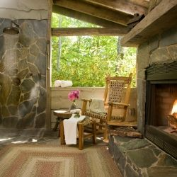 Outdoor Shower and fireplace overlooking Smoky Mountains at The Swag Inn near Asheville NC - I can hardly imagine a place so private that your shower is on the balcony.