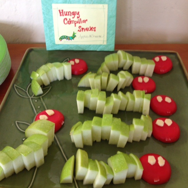 Hungry caterpillar healthy snack for our bug birthday. Dip the apple slices in orange juice, so they won't brown.