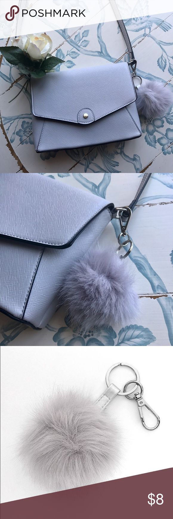 LC Lauren Conrad Faux Fur Keychain Perfect on a purse or your set of keys. The color is a purple grey that pairs well with a neutral purse for a pop of color. LC Lauren Conrad Other