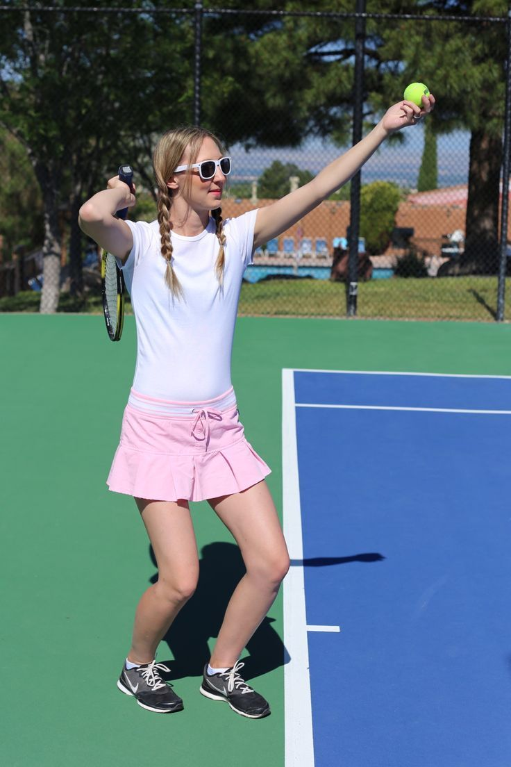 cute tennis outfit - active wear clothes .  Pink athletic skirt with a white t-shirt paired with Nike sneakers and white sunglasses for a casual country club outfit.  See more the tennis game and outfit here: http://www.dressesanddenim.com/tennis-outfit/