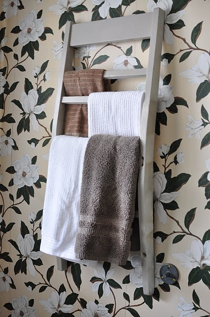 recycled chair back becomes bathroom towel rack.