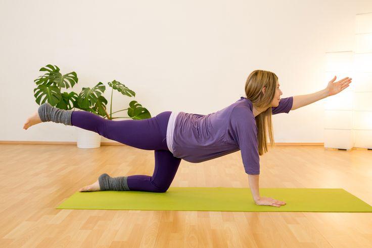 Yogastellung gegen Rückenschmerzen Tigerin