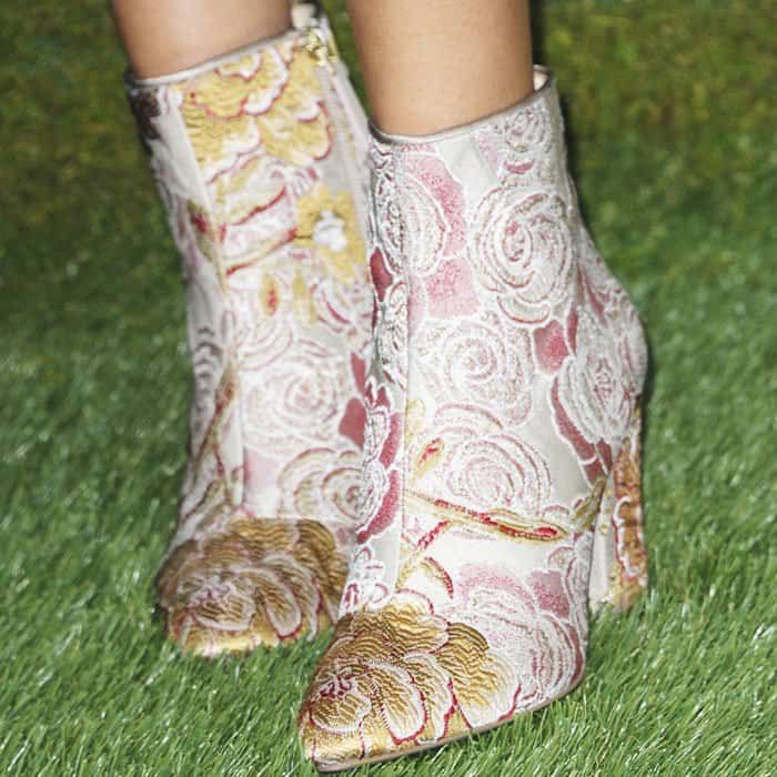 """Not your typical polo shoes: Victoria picked out a pair of jacquard print """"Savitra"""" boots from Nine West"""
