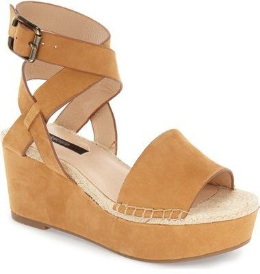 from nordstrom. Espadrille trim adds a touch of rustic appeal to a lofty platform wedge sandal topped with smooth leather straps..