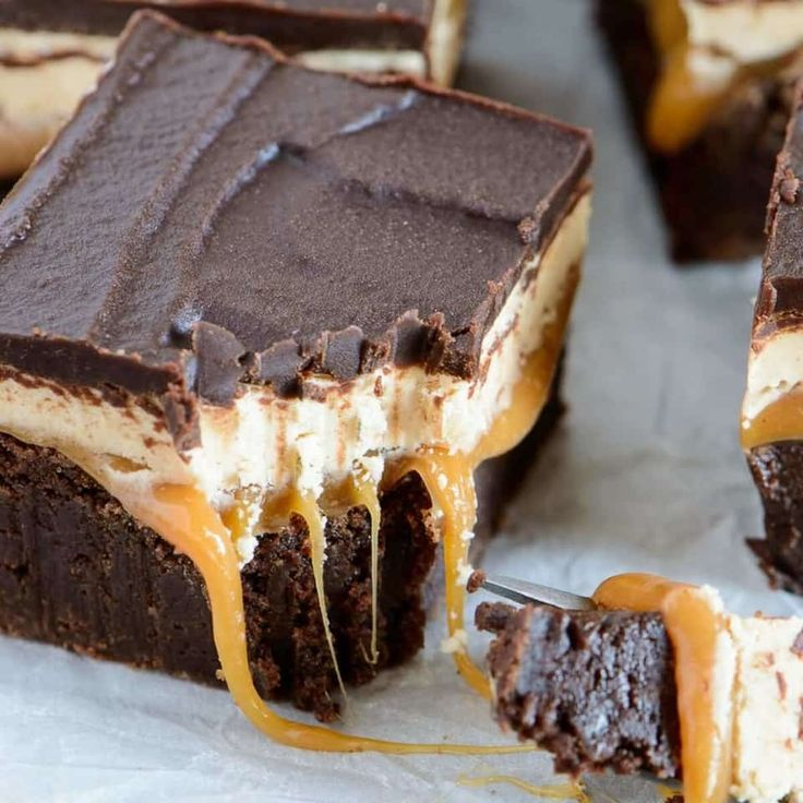 Enjoy this decadent recipe for four layer Snickers Brownies. These will satisfy the most insane sweet tooth!
