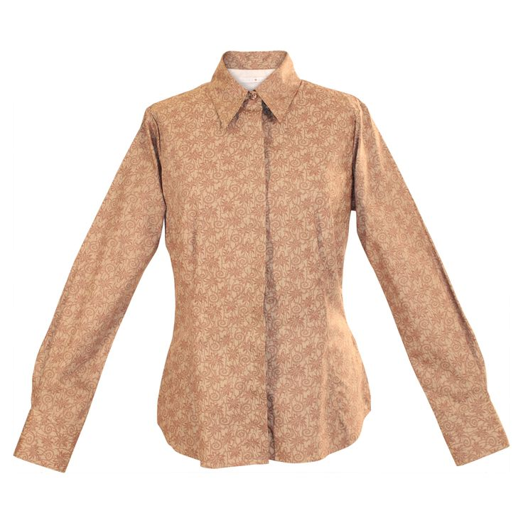 Wake up neutral suits with a pop of pattern. This slightly fitted cotton blouse is dressed up with a soft sheen and a subtle print, adding a little buzz to khaki or camel coordinates. Smart seams, flattering lines and a crisp collar complete the look. http://www.byariane.com.au/Louka-Print