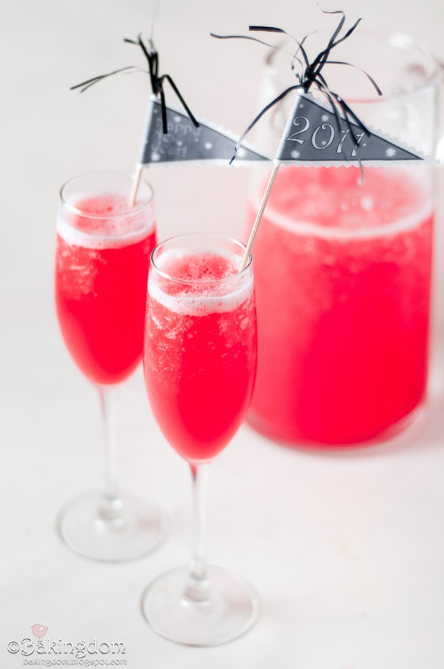 """Pitcher and two glasses of saturated color punch. """"New Years"""". Miniature idea."""