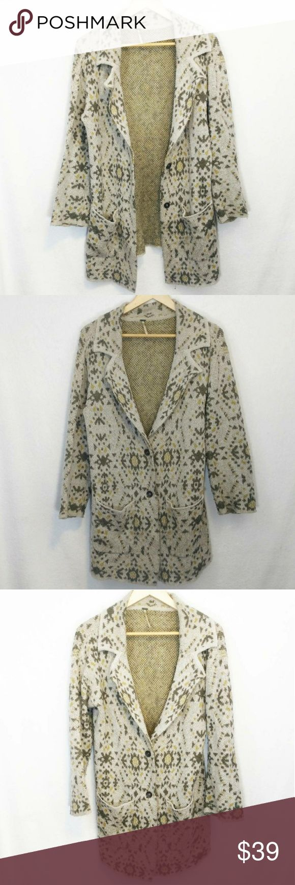 Free People Southwestern Duster Alpaca Cardigan Cardigan by Free People.  A long neutral toned cardigan with a print of geometric southwestern or Aztec shapes of triangles, abstract suns and more.  Has hues of tans, browns and muted yellows.  Has a deep v neck front with a lapel.  Buttons in the front with two buttons.  Has two functional pockets on the front.  Long sleeved.  Made of acrylic, nylon, wool and alpaca.  Has fuzzing and pilling throughout, examples shown in the last photo.  Size…