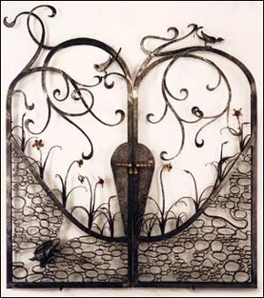 "The ""Bunny Gate."" Above-and-below-ground themed piece with several animals and birds forged from mild steel, and forged bronze daffodils. Size: 7' wide by roughly 9' tall. (Designed by Kirk McNeill, Freedom Forge)"