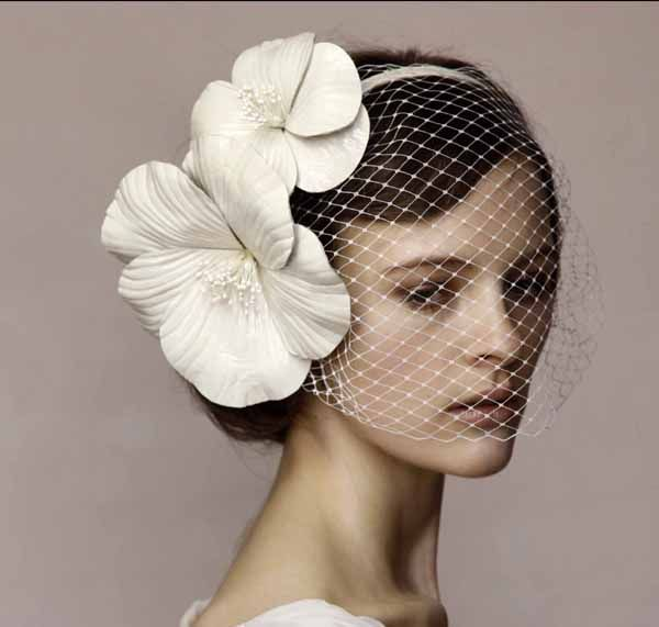 According to the popular belief, brides were traditionally wearing the veil in order to conceal from the demons. The contemporary brides wear veil to honor the traditions and accentuate their wedding gowns.