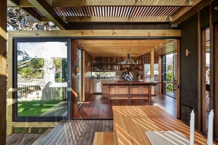 New Zealand beach house transforms into an open-aired paradise