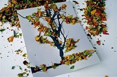 Smash up some fall leaves into tiny pieces. If the leaves are soft, throw them in the microwave for a minute or so to make them crunchy. Get black paint that comes with a brush. Paint lines on a piece of paper, sort of in the shape of a tree. Use a straw to blow on the paint and create branches. Put glue on the tree after the paint dries. Toss your crunchy leaves on top of the paper
