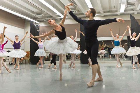 Grigory Popov, Saniya Abilmajineva, and BJC company dancers in rehearsal for Swan Lake