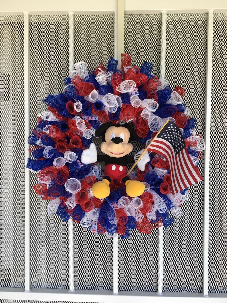 Mickey Mouse patriotic Wreath I made using Dollar store mesh, and wire wreath frame. Added Mickey Mouse and flag:):):)