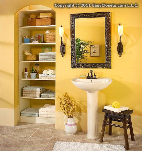 Deep Adjustable Closet Shelving Stores Towels And Bath Items Neatly In This Beautiful Bathroom Linen