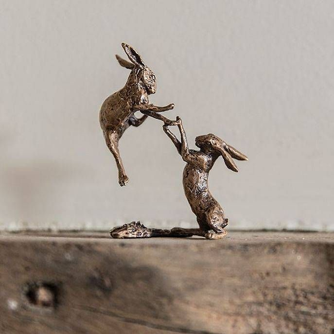 miniature bronze boxing hares statue by ginger rose   notonthehighstreet.com