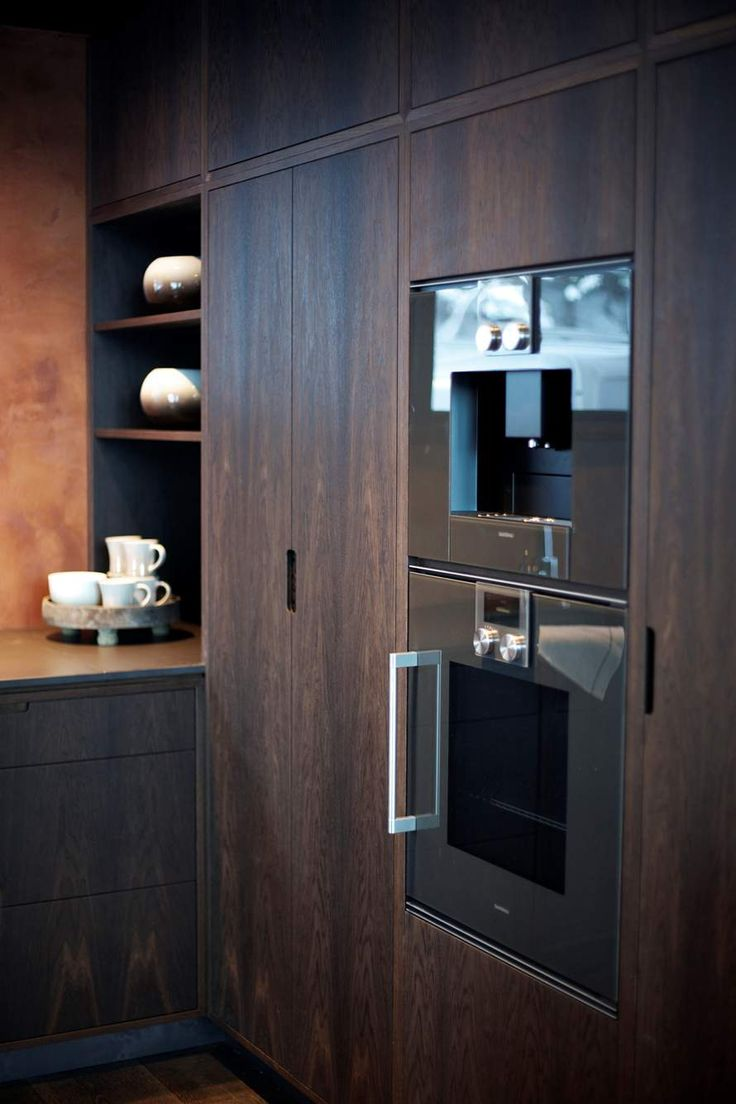Hamran + Tingbø. Hamran Kitchen. Extraordinary kitchens from Norway. Kitchen inspiration. Scandinavian design. Ceramic worktop. Integrated pulls/cut outs for handles. Cut out kitchen cabinet pulls. Smoked oak cabinets. High cabinets. Dark Kitchen. Gaggenau appliances.