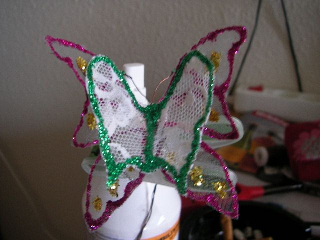 butterfly  .. used lace , a old giftbag from parfume, glue, glitter and some wire