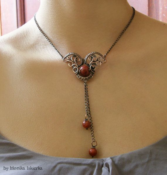 Derry- wire wrapped necklace with red coral.. Oxidized, hammered and polished copper wire for ancient, old looking, vintage effect. 100% Handmade. Made by Monika Iskierka.