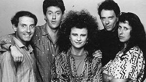 Cast of The Tracey Ullman Show, 1987. Left to right: Dan Castelleneta, Sam McMurray, Tracey Ullman, Joe Malone, Julie Kavner