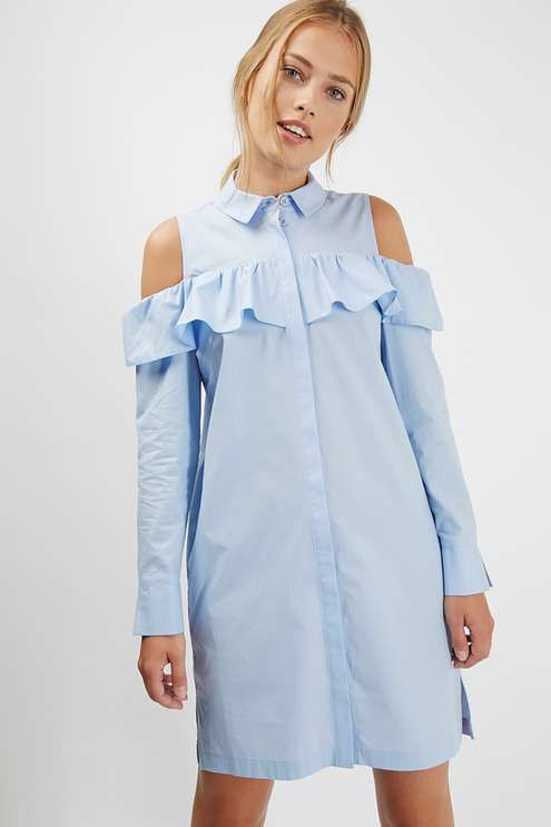 Add interest to the shirt dress by leaving your shoulders on show. Crafted with an all-over pinstripe, this staple shirt dress features a classic collar and button down detailing, and comes finished with a cutesy style ruffle to the bust. #Topshop