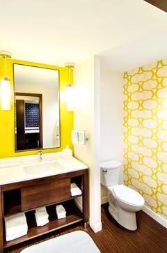 Create the perfect powder room with these tips and tricks. When choosing accents for your powder room, consider a tall, thin, frameless mirror and ambient lighting such as pendants . Placing ambient lighting on either side of this type of mirror will help create extra light, while also extending the space. Also, choosing a dramatic wallpaper will help make the space feel cozy, but be sure to leave the ceiling white for a more dimensional touch.