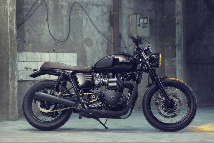 Not long ago we witnessed their craftsmanship with a custom Honda CB650C, but with today's feature a Triumph Bonneville T100 Custom these