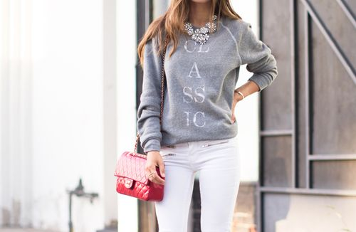 Gray 'Classic' sweatshirt, white denim jeans, statement necklace, and red Chanel bag.