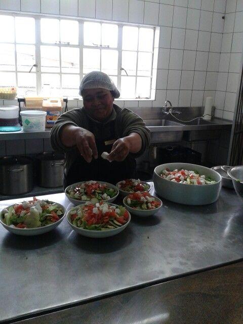 Safari restaurant staff making garden salad.