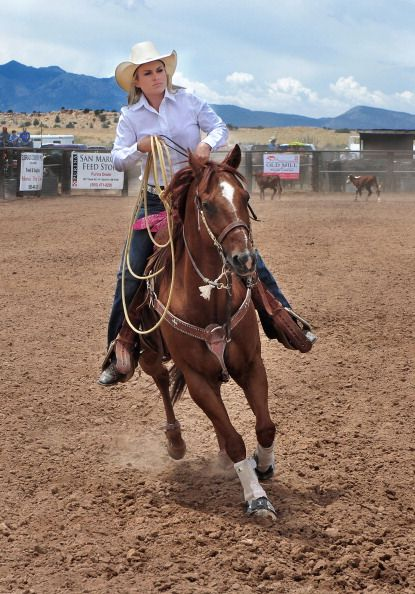 A rodeo cowgirl prepares to compete in the breakaway roping contest at the Rodeo de Galisteo an amateur rodeo in the small village of Galisteo in...
