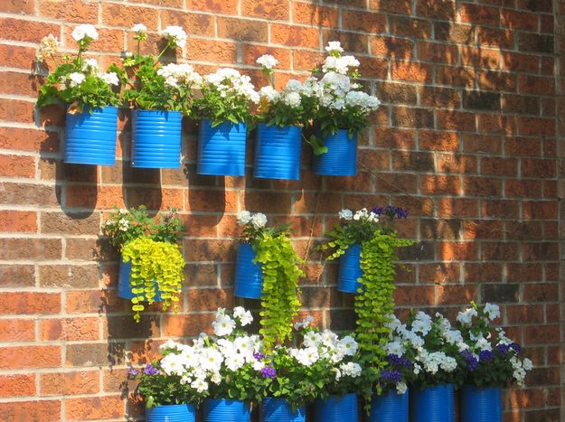 Cool way to reuse :) Recycled Can Wall Planters | 30 Creative DIY Ways To Show Off Your Plants