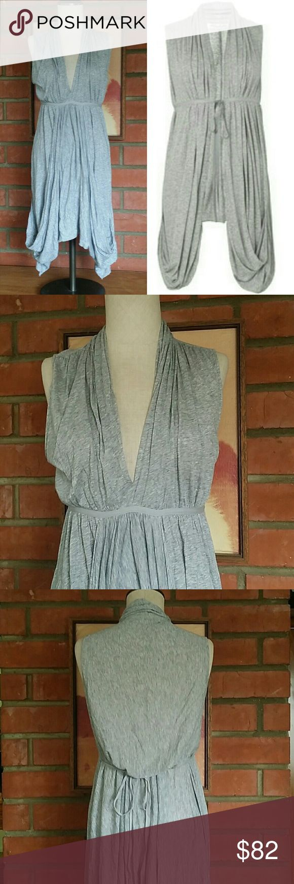 All Saints Spitalfields Salacia Dress Size 10 (runs a tiny bit small do it would fit more of an 8 ) Heather grey color Empire waist ties in the back Euc very gently worn with no issues of any kind. All Saints Dresses
