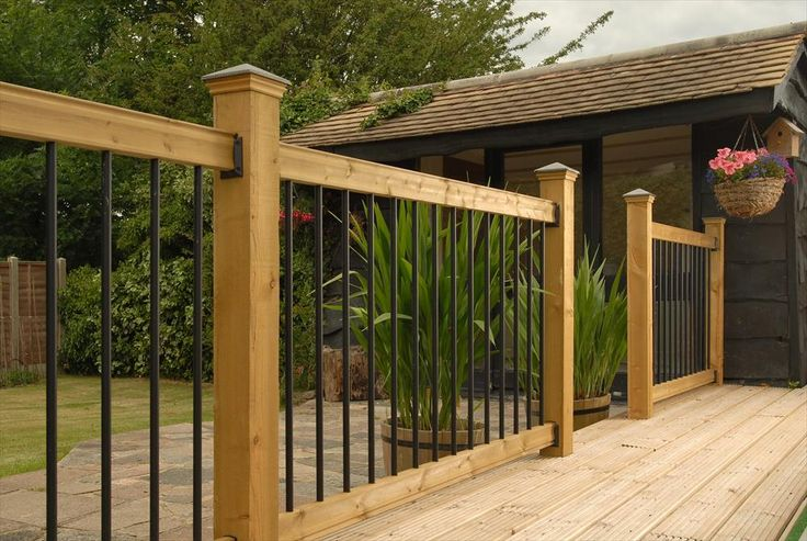 BuildDirect – Traditional Series Wood Railing Kits – Pine - Straight Black Baluster - Outdoor View                                                                                                                                                      More