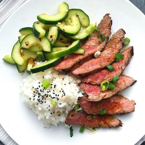 Let this Korean-style flank steak launch your weekend. Get the recipe: Korean-Style Grilled Flank Steak with Sticky Rice and Spicy Cucumber Salad