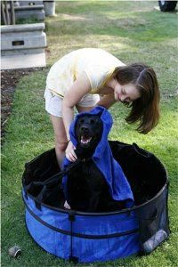 Portable Dog Bath! This would certainly make bathing Kim easier