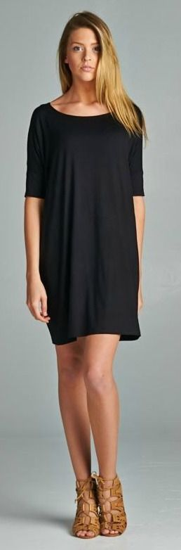 "Loose fit tunic dress. Round neck. Drapes well. Length: 31"". 95% Rayon, 5% Spandex. Made in USA."